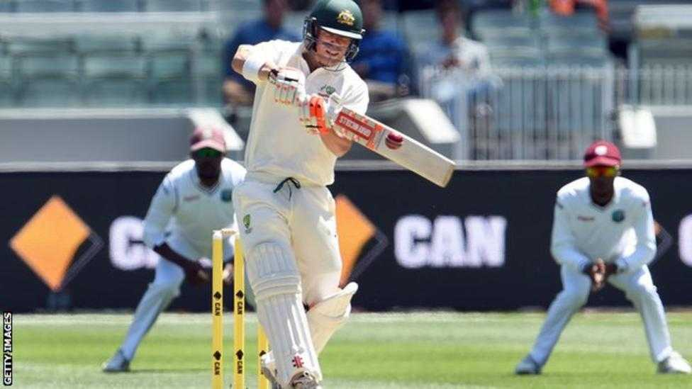 Opener David Warner reach an unbeaten 122 as Australia brought on a rain.