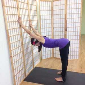 Yoga Poses at work against the wall